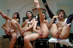 Four naked girls caress each..